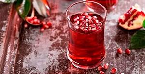 zumo de granada mollar Granavida® en vaso con hielo